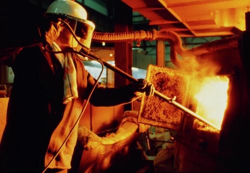 steel-worker-checking-contents-of-furnace-heine-schneebeliscience-photo-library.jpg