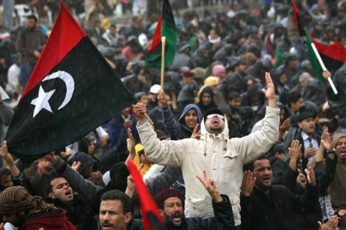 opposition-supporters-pray-in-the-rain-in-benghazi-libya-pic-getty-172386923.jpg