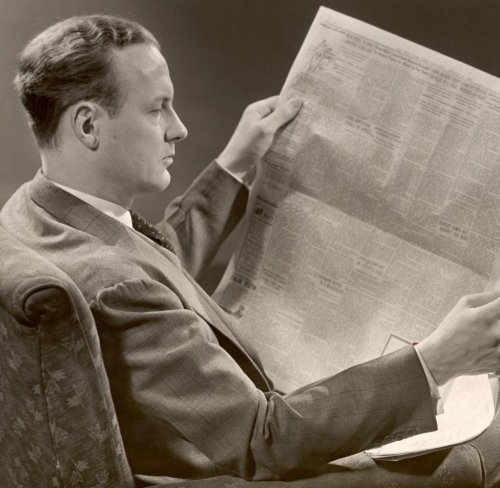 Man-Reads-A-Newspaper.jpg