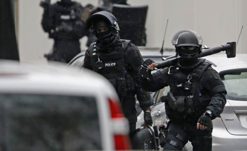 French_police_manhunt_Reuters_650_bigstry.jpg
