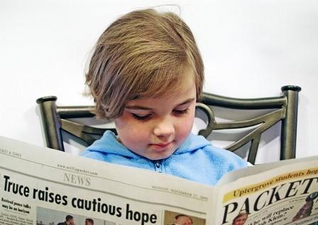 Child-Reading-Paper.jpg