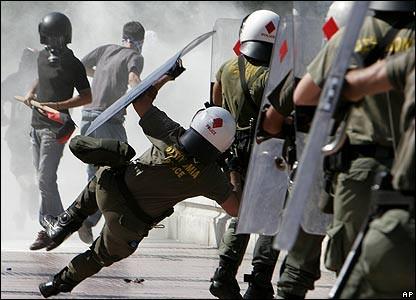 greek-riot-police-falling.jpg