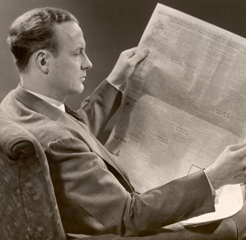 A-Man-Reads-A-Newspaper.jpg