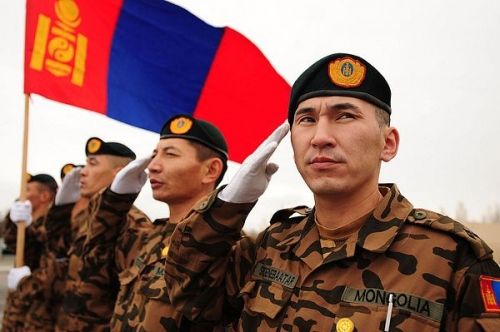 thediplomat-mongolian_army_soldiers_salute_while_their_nations_flag_waves_in_the_breeze_at_the_transit_center_at_manas-1.jpg