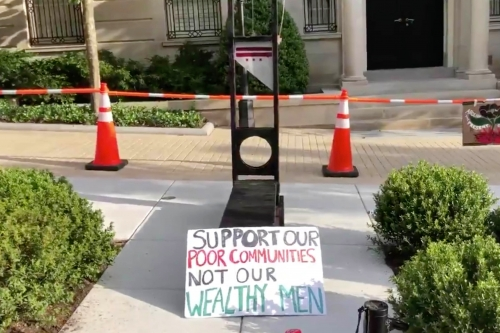 Protesters-set-up-guillotine-in-front-of-Jeff-Bezos-DC.jpg